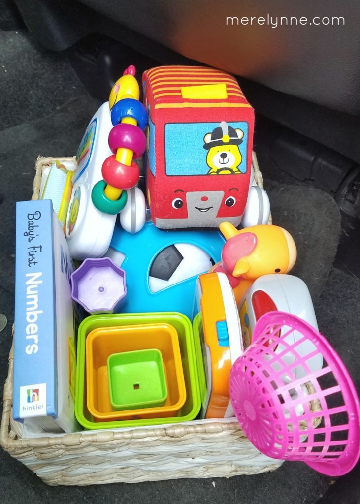 road trip with baby, road trip with kids, how to organize toys in the car, easy road trip with a baby