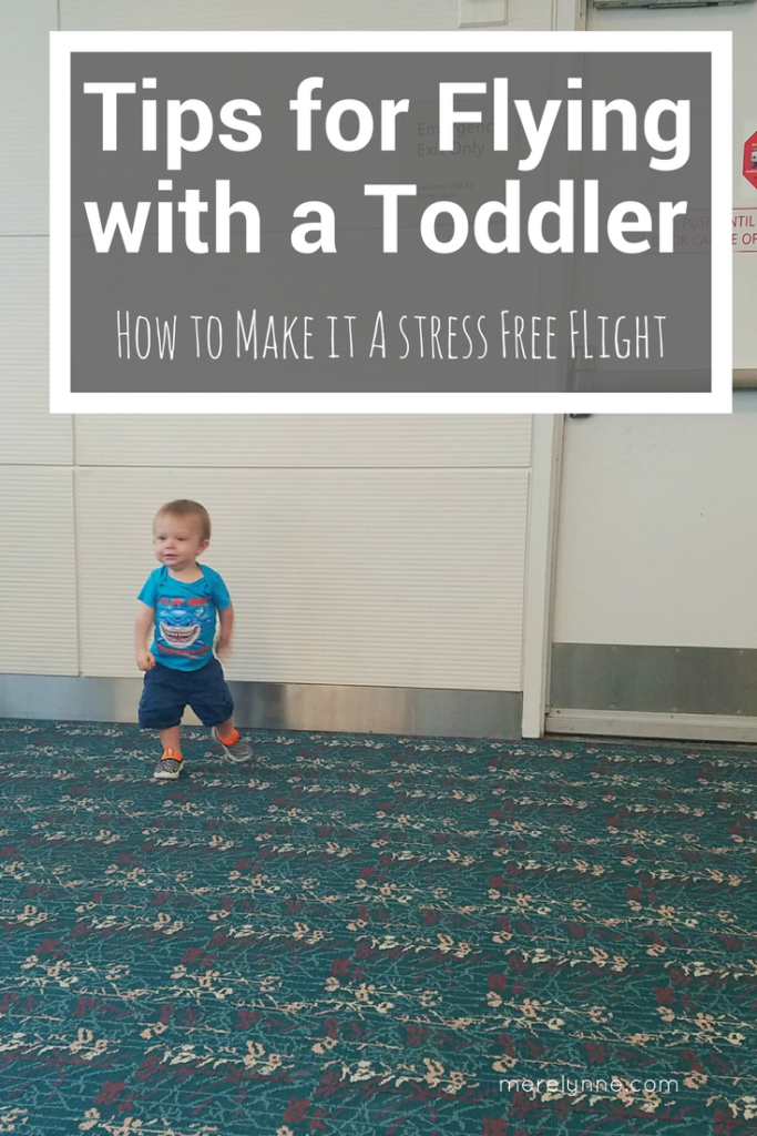 tips for flying with a toddler, traveling with a toddler, flying with a baby, how to fly with a baby, how to fly with a toddler